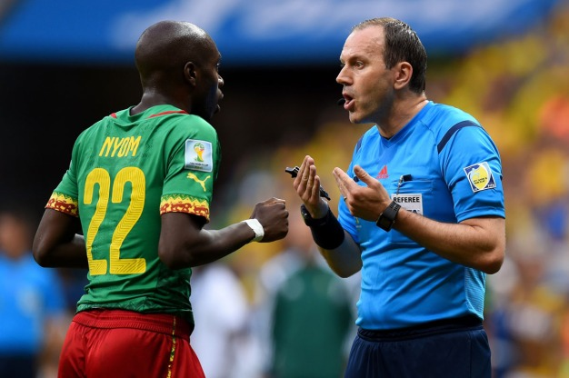 BRASILIA, BRAZIL - JUNE 23: Referee Jonas Eriksson speaks to Allan Nyom of Cameroon during the 2014 FIFA World Cup Brazil Group A match between Cameroon and Brazil at Estadio Nacional on June 23, 2014 in Brasilia, Brazil.  (Photo by Stu Forster/Getty Images) ORG XMIT: 491695299